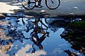 Picture Title - Cyclist in puddle