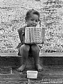 Picture Title - A little girl with accordion