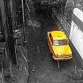 The yellow taxi in the rain