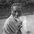 Picture Title - elderly man smoking a bidi.